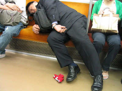 salary-man-sleeping-on-the-subway
